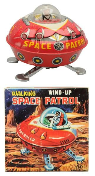 Lot # : 618 - Tin Litho Wind-Up Walking Space Patrol.