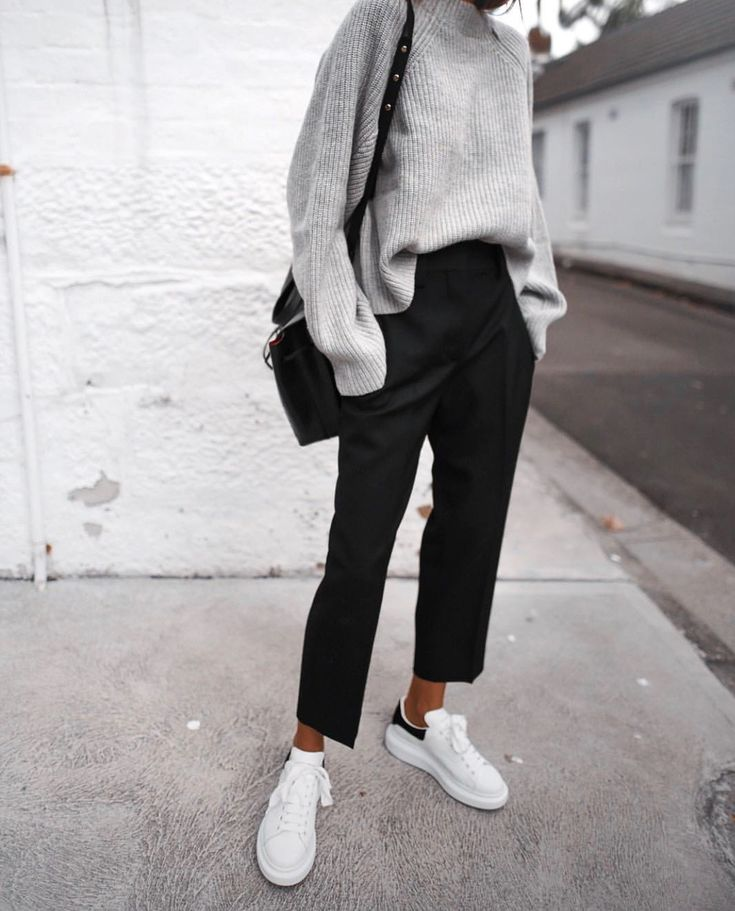 grey sweater, black pants and white sneakers