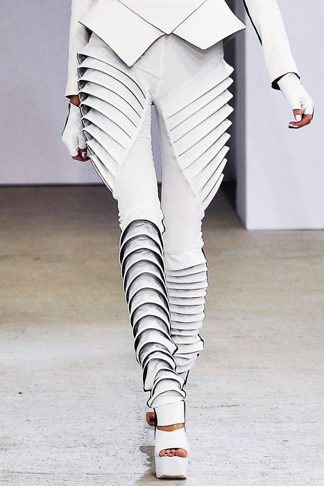 The innovative repetition of the lines in the pants impersonate a star wars outfit adding a sense of masculinity to the garment.
