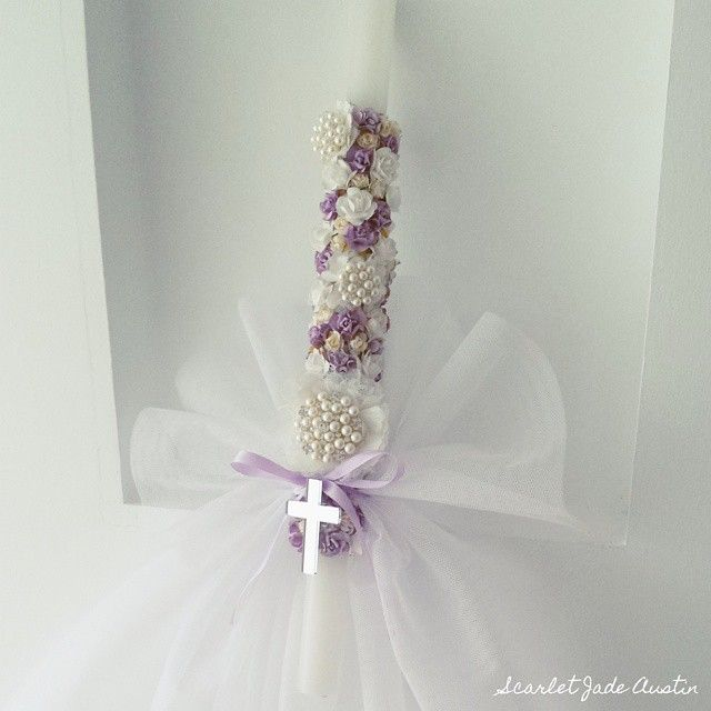 Instagram media scarletjadeaustin - Palm Sunday candle...again design credit goes to @hope_creations_marynehme. Her candles are her signature and she deserves all the credit for this one. #scarletjadeaustin #palmsundaycandles #palmsunday #candles #eastercandle #lambatha #mirrorcross #tulle #easter #fabricflowers #paperflowers #vintage #floralcandle #purple