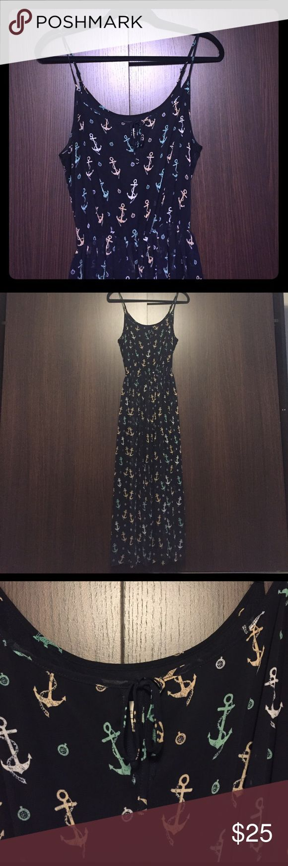 Nautical maxi dress Super cute maxi. Lining goes all the way down. Navy blue with colored anchors. No flaws. Cinches at the waist. Ties in the front. Straps are adjustable. Maison Jules Dresses Maxi