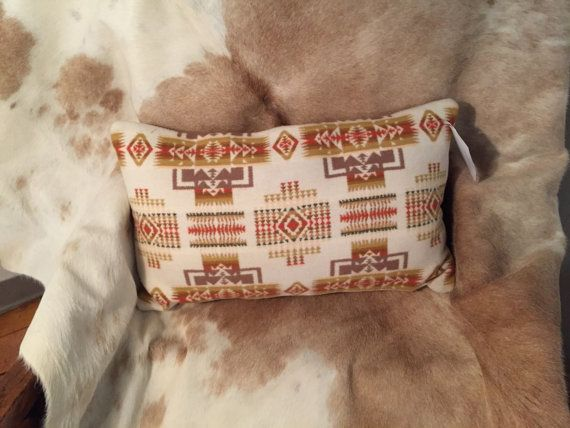 """$55.00 11 x20"""". Throw pillow made with authentic Pendleton® wool blanket fabric with microfiber back  pillow insert included.  Size 20 x 11.  www.nativetwist.weebly.com  Message me if you are interested in a custom order."""