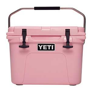 YETI Pink Roadie 20 Cooler Designed to bring awareness to breast cancer, this special cooler may be small in size but it's big on performance! The easy-to-carry Roadie features Doublehaul™ handles that have a military-grade nylon rope with a heavy-duty textured grip, Permafrost™ Insulation, molded-in T-latches, gasketed lid, self-stopping hinge, and impact-resistant, roto-molded, polyethylene construction. Capacity is 20 quarts, which translates to 14 long neck bottles or 15 12oz. cans—along…
