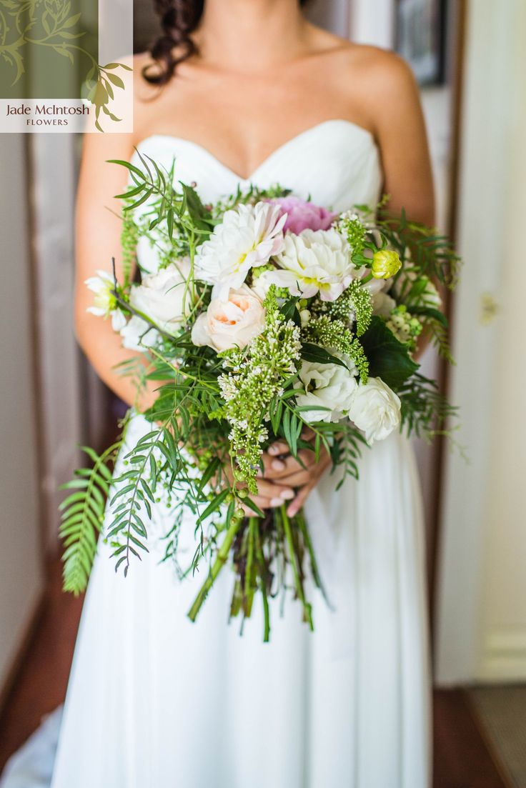 Jess's unstructured posy of peachy pinks, white tones and green features dahlias, clethra, snowberry, buddleja, white lisianthus, local and imported david austen roses, ferns, pepper corn berry and foliage. It's a little bit wild but so pretty. www.jademcintoshflowers.com.au