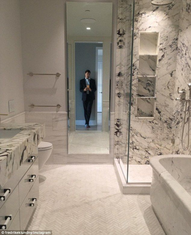 Welcome home: Fredrik Eklund revealed the first glimpse of his and husband Derek Kaplan's new multi-million dollar New York condo on Tuesday - namely his marble filled bathroom