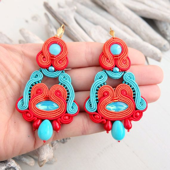 Oriental ethnic chandelier earrings in turquoise red colour made in soutache technique. * material : satin cords, beads, suede  * hooks : metal  * back side : beige suede  * total size : 3.39 x 1.73 ( 8.6 x 4.4 cm )   This earrings are made to order and it takes 1-2 weeks to process order. If you in a hurry, please contact me prior to ordering.   All my jewellery has been IMPREGNATED with super nano protector against dirt and damp.  If you have any questions please dont hesitate to ask me…