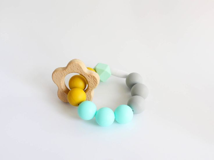 Teething Bracelet. Bpa free silicone beaded bracelet with natural wooden flower ring teether ring by Mustard & Mint by mustardandmintuk on Etsy https://www.etsy.com/uk/listing/523049505/teething-bracelet-bpa-free-silicone