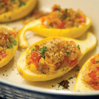 Scoop up a serving of tomato-pepper-bacon stuffed squash for a tasty summer treat.