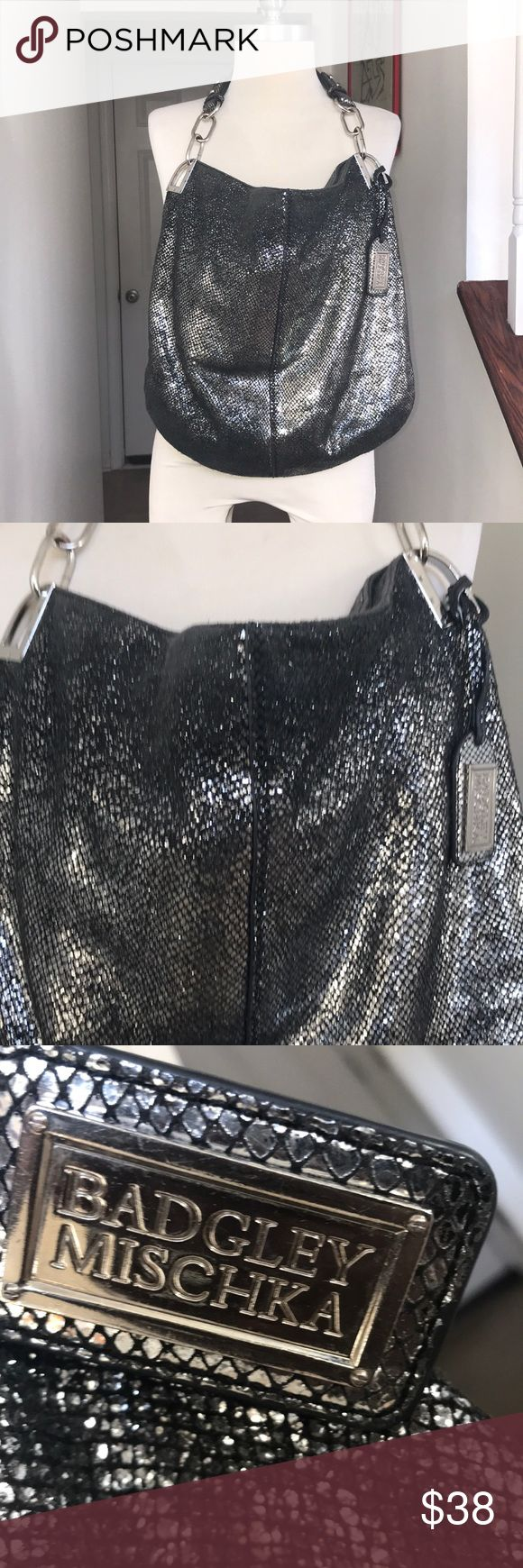 Badgley Mischka Silver Tone Pewter Leather Hobo😘 Title Says it All😘😘 This bag is well loved and very worn but still have plenty of use Life left in it. This is not a bag that need babying. It has some rub spots at the top for going in and out of it. The interiors is clean and the hang tag will be coming with it. No dust bag. Priced based upon condition. 😘😘 Badgley Mischka Bags Hobos