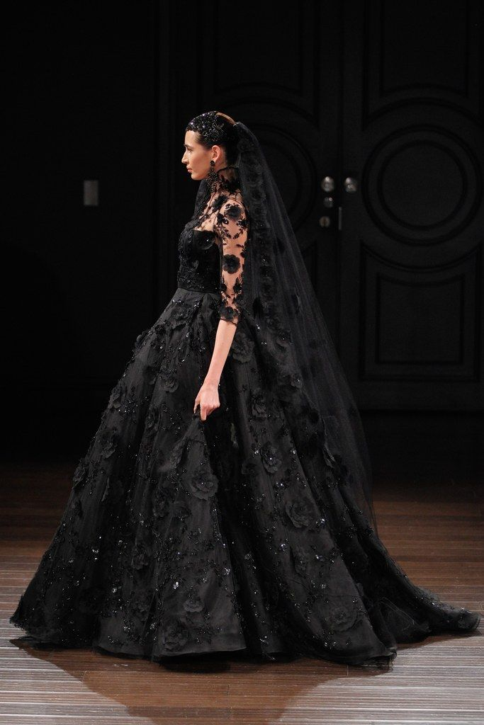 Naeem Khan's spring 2017 bridal collection included amazing wedding dresses on the runway (including this stunning black lace ballgown).
