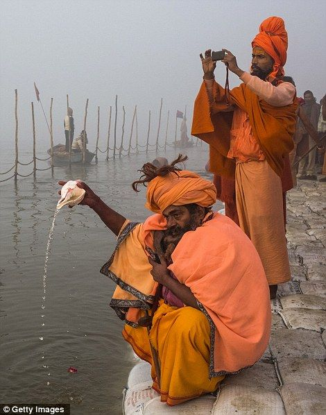 Holy Men Gather on the River  (Love the guy with the camera, the old mixing with the new)