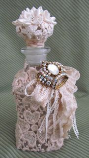 I have a few yards of this dark beige floral lace   and today I used it in a few of my projects.   Here I covered a perfume bottle..    ...