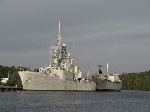 The once great, former Royal Canadian Navy destroyer H.M.C.S. Fraser (DDH 233) alongside in the estuary of the Lahave River on June 4th., 2009, while her ultimate fate is eventually decided.. This ship was towed out of Bridgewater and taken by tugs to Halifax on Tuesday, July 21, 2009 and further to Ontario, in a following year, where it was broken up for salvage.