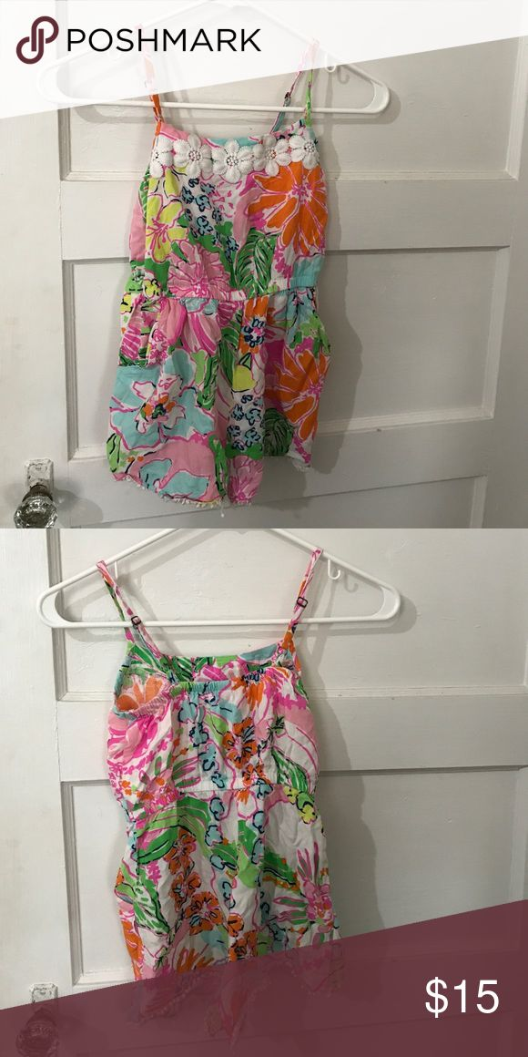 Girls Lilly Pulitzer for Target romper Cute romper from Lilly Pulitzer for Target line. Has flower details at neckline and pom Poms on bottom. Some Pom poms are loose but otherwise great condition Lilly Pulitzer for Target One Pieces Bodysuits