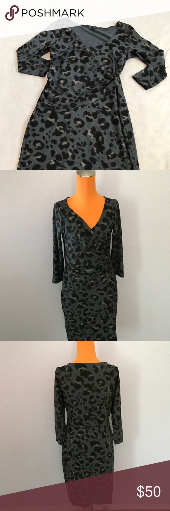 """Ann Taylor Gray Animal Ruched Side Sleeved Dress 37.5"""" length 18"""" armpit to armpit. Gray animal print leopard dress. Stretch style. 3/4 Sleeve. Ruched Side for style and flattering look. Excellent condition. Bundle 2+ items for a discount Ann Taylor Dresses Long Sleeve"""