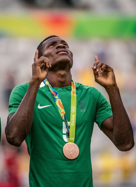 Nigeria's Saturday Erimuya reacts after receiving the bronze medal during the medal ceremony after defeating Honduras in the Rio 2016 Olympic Games men's bronze medal football match at the Mineirao stadium in Belo Horizonte, Brazil, on August 20, 2016.  / AFP / GUSTAVO ANDRADE