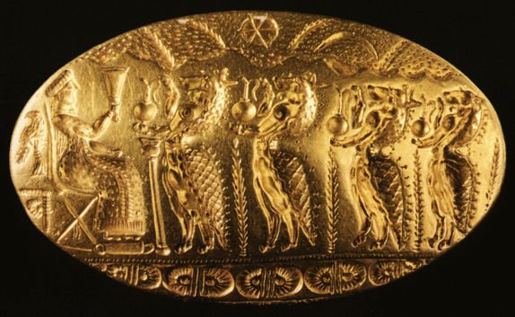 A procession of animals dressed as women approach a seated goddess, bearing ewers and other offerings. Gold ring from Tiryns, Greece, circa 1500 bce.
