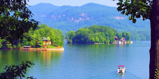 Lake Lure is nestled in the foothills of the Blue Ridge Mountains of North Carolina. Located about 27 miles from Asheville, Lake Lure sits i...