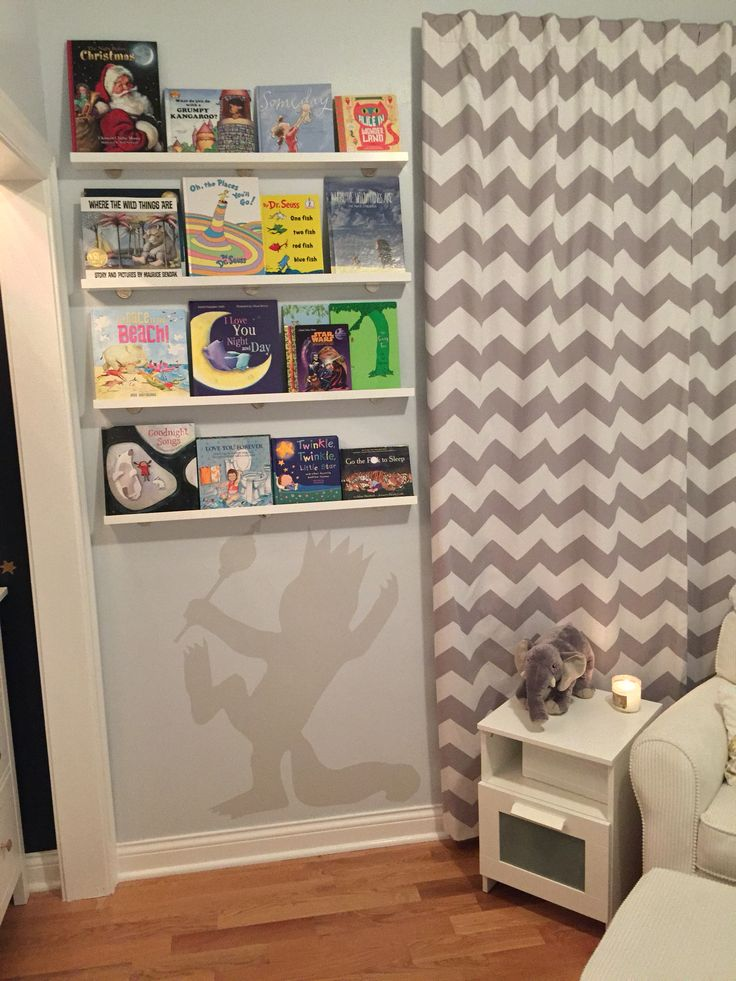 Where the wild things are nursery! Our modern take on the childhood book!  shelves from the container store, curtains from pottery barn kids, chair from kids are us, and side table from ikea.