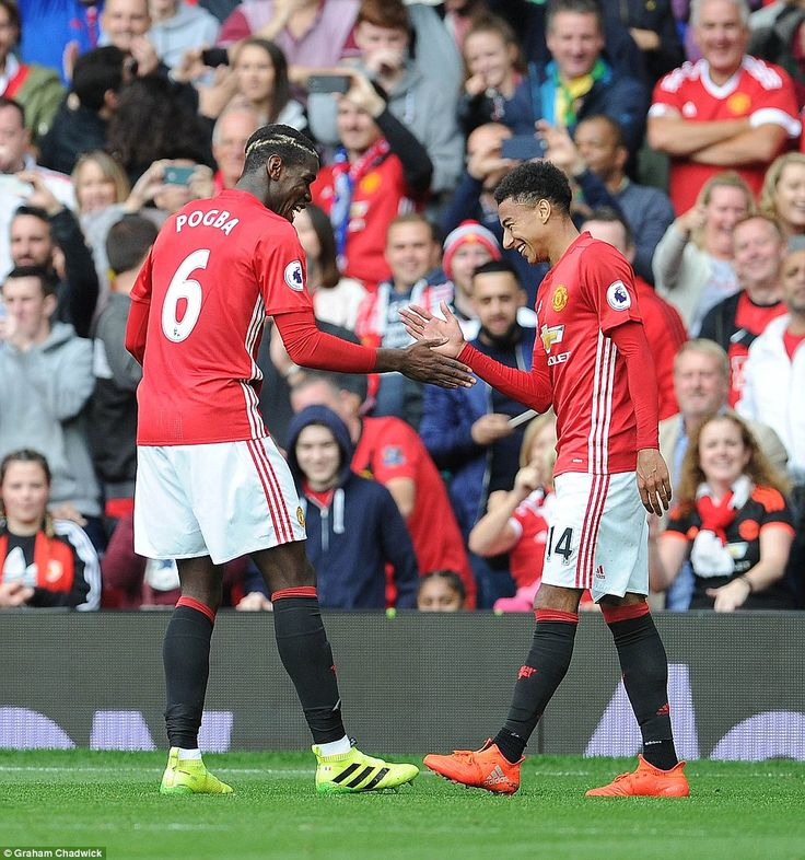 Pogba celebrated his goal with Jesse Lingard as United ran rampant in the first-half at Ol...