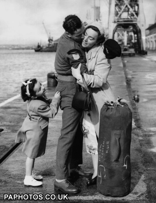 One little girl who didn't want to be left out of a joyful reunion was Kathleen, 4, tugging at her father, Rifleman Ronald Green, a Korean War POW, as he greets his wife, Kathleen, at Southampton docks after being repatriated to England. 1953