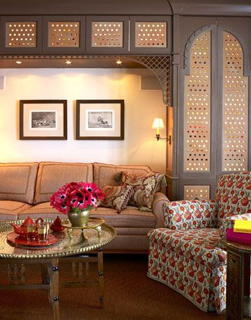 Moroccan-Style Family Room  In this Moroccan-style family room, a small office is neatly tucked behind carved lattice doors, and the sofa pulls out for guests. Designed by Christopher Maya.