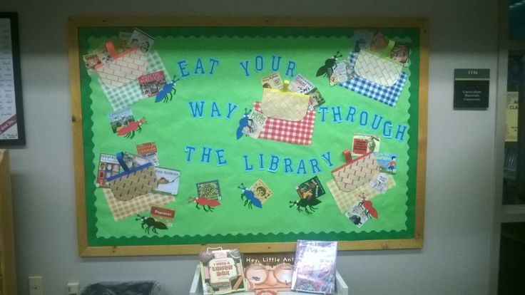 June/July bulletin board features summer reading at an ant picnic.