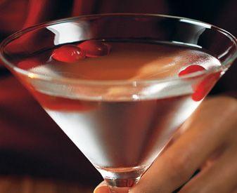 Winter White Cosmopolitan (2 oz Cranberry Vodka  0.75 oz Cointreau  1 oz Fresh Lime Juice/Simple Syrup Mixture  2 oz White Cranberry Juice  3 to 4 Cranberries for garnish)