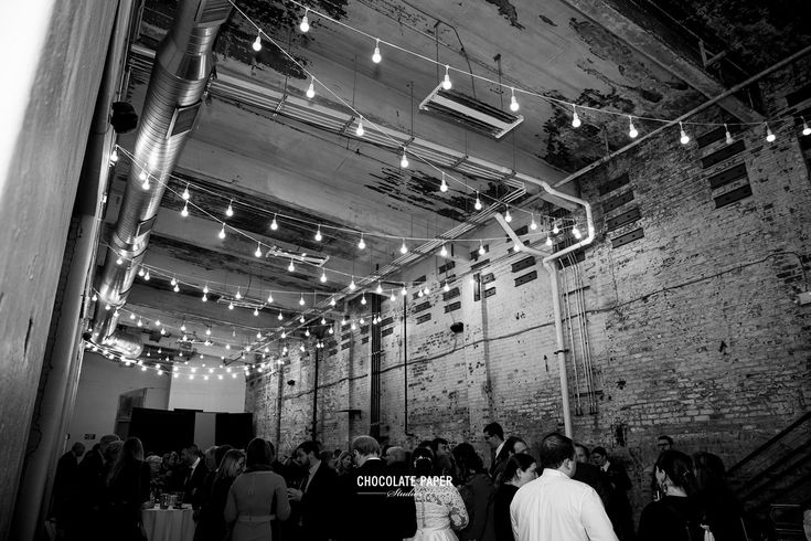 Dimmable bistro lights are the main source of light in Rhinegeist's Annex space. Photo by: Chocolate Paper Studios