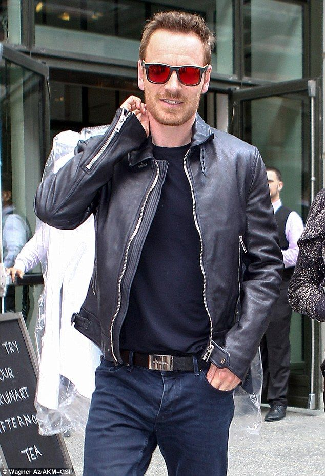 That's more like it! Michael Fassbender stepped out in New York on Thursday with his handsome face on full display as he hit the promo trail for new film Frank, in which he wears an oversized papier-mâché head