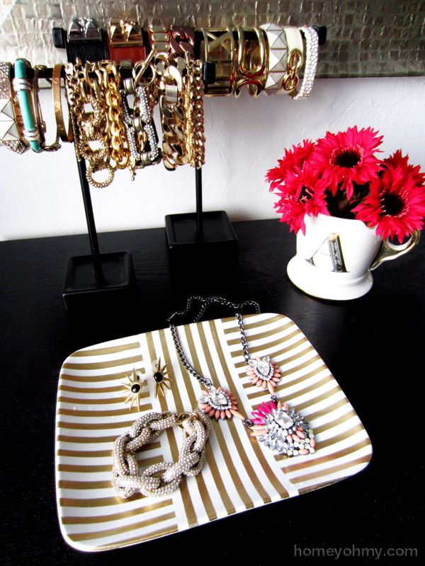 Gorgeous jewelry tray made with a plate and gold leaf pen.