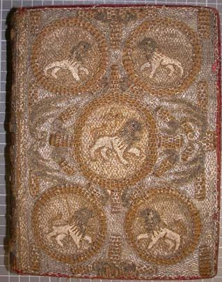 Detail of the beautiful embroidered binding showing the lion motif. Amsterdam 1633