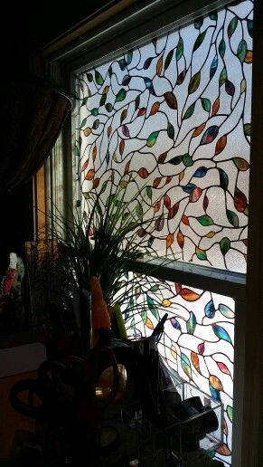 """From Home Depot, I bought """"faux"""" stained glass- no need for curtains, total privacy & very pretty too. $20 a roll.."""