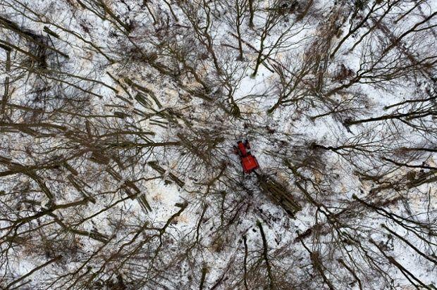 Kacper Kowalski new book Side Effects:  Woodcutters in the forest near Gdynia.