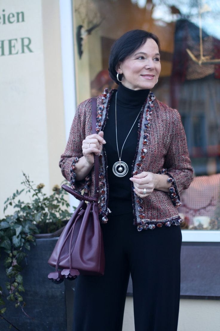 Transitional look in black palazzo trousers and a cropped bouclé jacket by Öady of Style 50plus