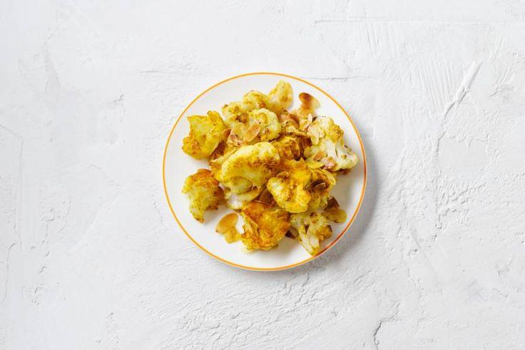 7 september - Bloemkool in de bonus - Even kort koken, omscheppen met kerrie en hup, de oven in. Hartstikke makkelijk! - Recept - Allerhande