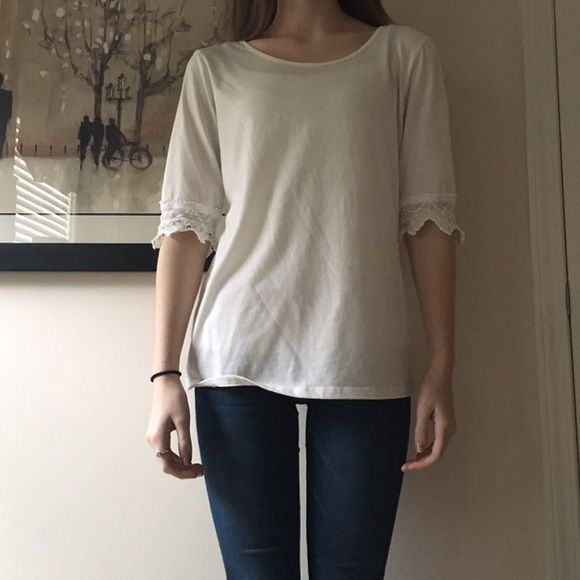 Plain white shirt W/ Low cut back Plain white shirt, hardly worn. (Beaded a little from bookbag) Willing to bargain!! Charming Charlie Tops