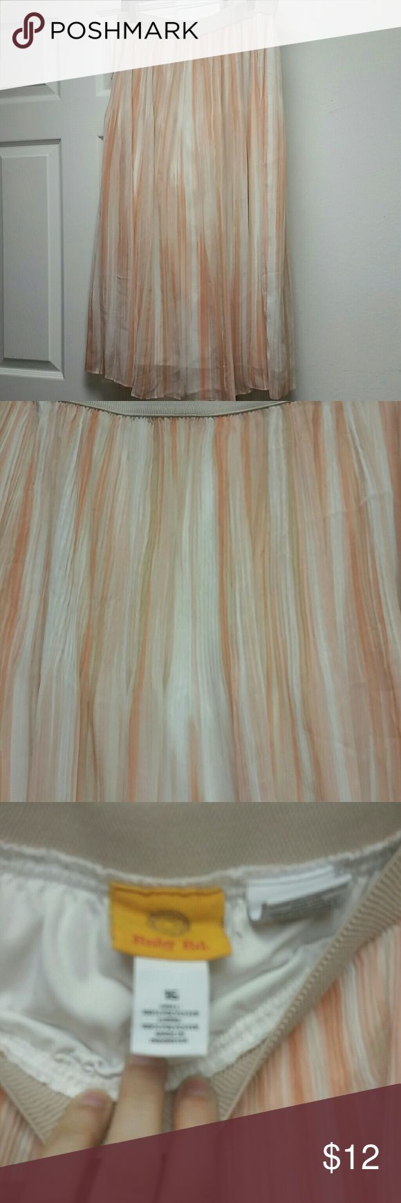 Maxi skirt Ruby Red woman's shades of peach lined maxi skirt. Has micro pleating detail at the top, more flowy at the bottom. Elastic waist. Perfect for spring and summer! Reasonable offers accepted through offer button. Smoke free, pet friendly home. Skirts