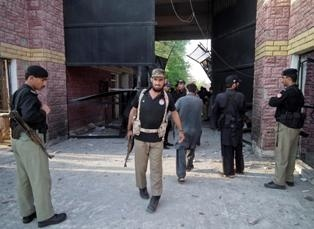 NEARLY 400 prisoners including militants escaped early Sunday (April 15) from a jail in northwestern Pakistan after an attack by insurgents armed with guns, grenades and rockets, officials said.