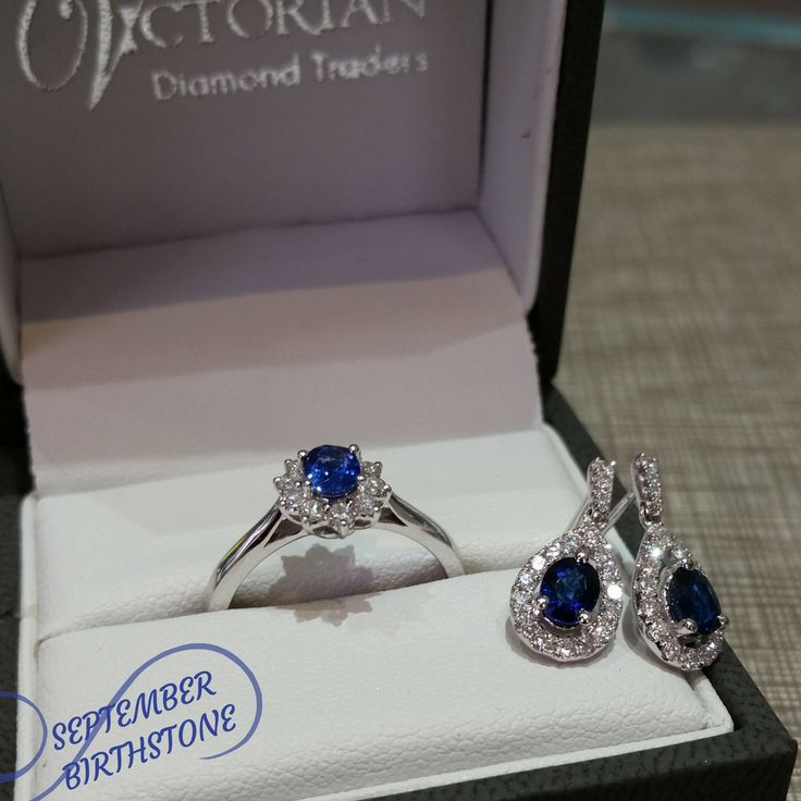 18 ct white gold sapphire with diamonds ring and earrings