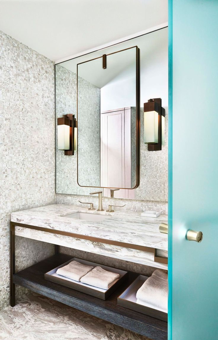 "modern traditional bathroom....modern bronze ""wash stand"" with marble top and apron, bronze modern wall sconces mounted on a mirror ..."