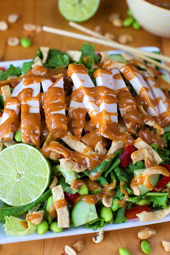 Inspired by a cozy little grill just down our street, this Thai chicken salad with peanut dressing is fresh, crisp and bursting with amazing flavor. It's a favorite!!!