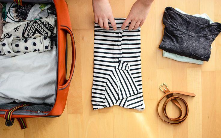rucksack packen kleidung rollen