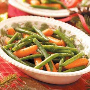 Glazed Carrots and Green Beans Recipe -This simple dish is always a big hit, even with non-vegetable lovers. I've substituted frozen green beans for fresh, omitting the blanching process, and it still tastes great.