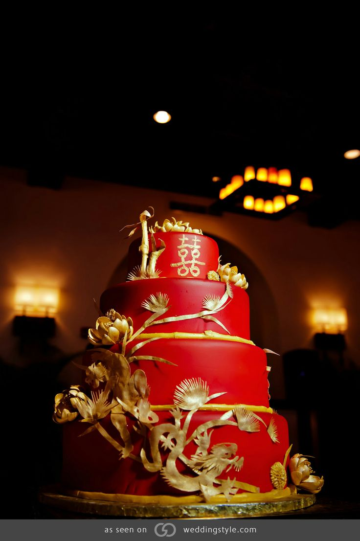 Four-tiered red fondant cake with bamboo, dragon, tiger and lotus flower details hand-cut out of rice paper #GOWS #platinumlist #weddingstyle #graceormonde #luxuryweddings