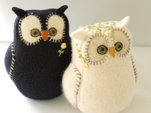 black and white hand made felt owls with stitchery