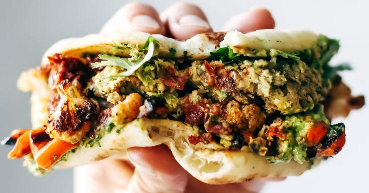 Naan-wich: 5 ingredient falafel, roasted veggies, and avocado sauce stuffed between pillowy garlic naan. Best sandwich recipe I've ever made.