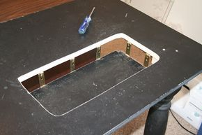 Modify a table top into an inset sewing machine center