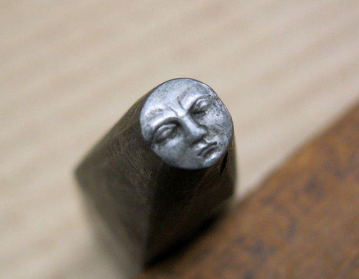 Moon face metal stamp.
