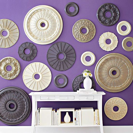 Medallion Magic: Make a statement with multiples. Scoop up a collection of ceiling medallions in various sizes and designs. Spray-paint the medallions and arrange on a wall as art. Try neutral medallions on a brightly colored wall, or do the reverse -- paint the medallions in fun colors and arrange on a neutral wall.